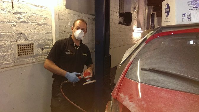 Richard preparing the bodywork on the new loan car